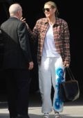 Heidi Klum keeps it comfy in a flannel shirt and sweatpants as she arrives to a photoshoot in North Hollywood, California