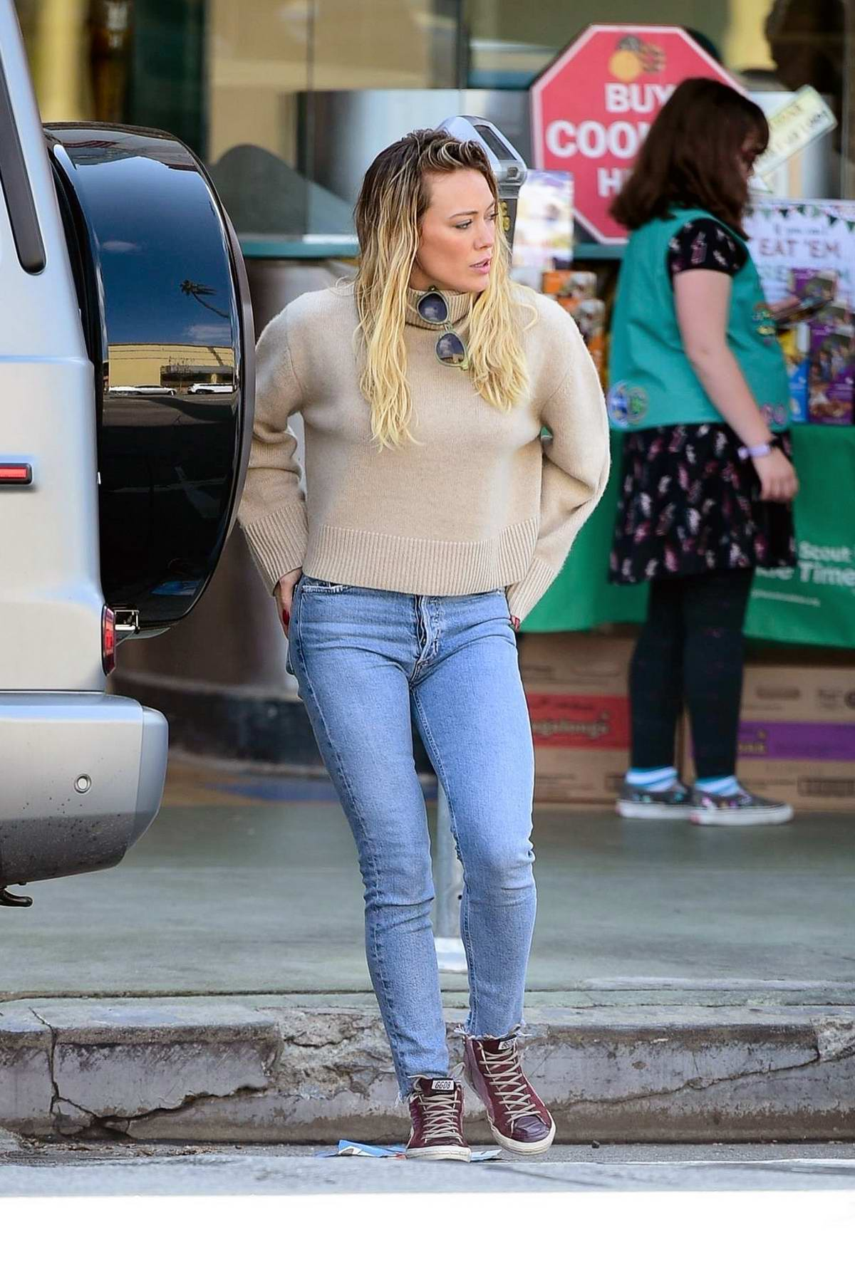Hilary Duff keeps it casual in a beige sweater and tight denim while out for some shopping in Studio City, California