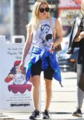 Hilary Duff sports a grey top and black legging shorts as she hits the gym in Studio City, California