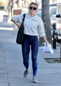 Hilary Duff sports a white hoodie and blue leggings while out running errands in Studio City, California