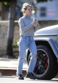 Hilary Duff wears a grey sweater and ripped jeans as she steps out for a coffee in Los Angeles