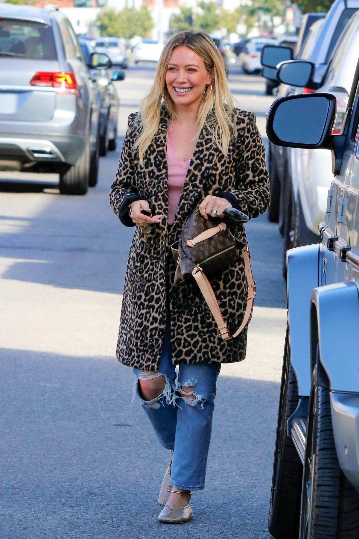 Hilary Duff wears a leopard print coat while out for lunch with a friend in Sherman Oaks, California