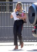 Hilary Duff wears a multi-colored striped top and leather pants while out for a meeting in Los Angeles
