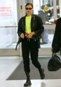 Irina Shayk dons a neon top with black leather jacket as she touches down at JFK Airport in New York City