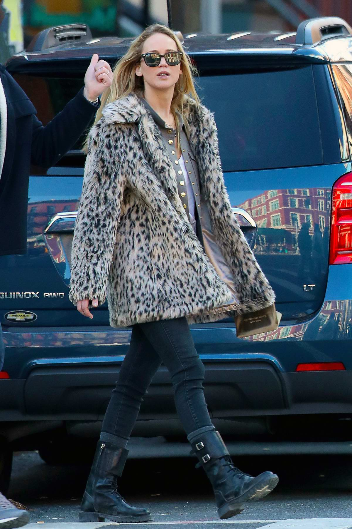 Jennifer Lawrence seen wearing an animal print coat while out and about with Cooke Maroney in New York City