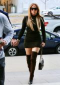Jennifer Lopez stuns in a form-fitting mini dress as she arrives for a business meeting in Beverly Hills, California