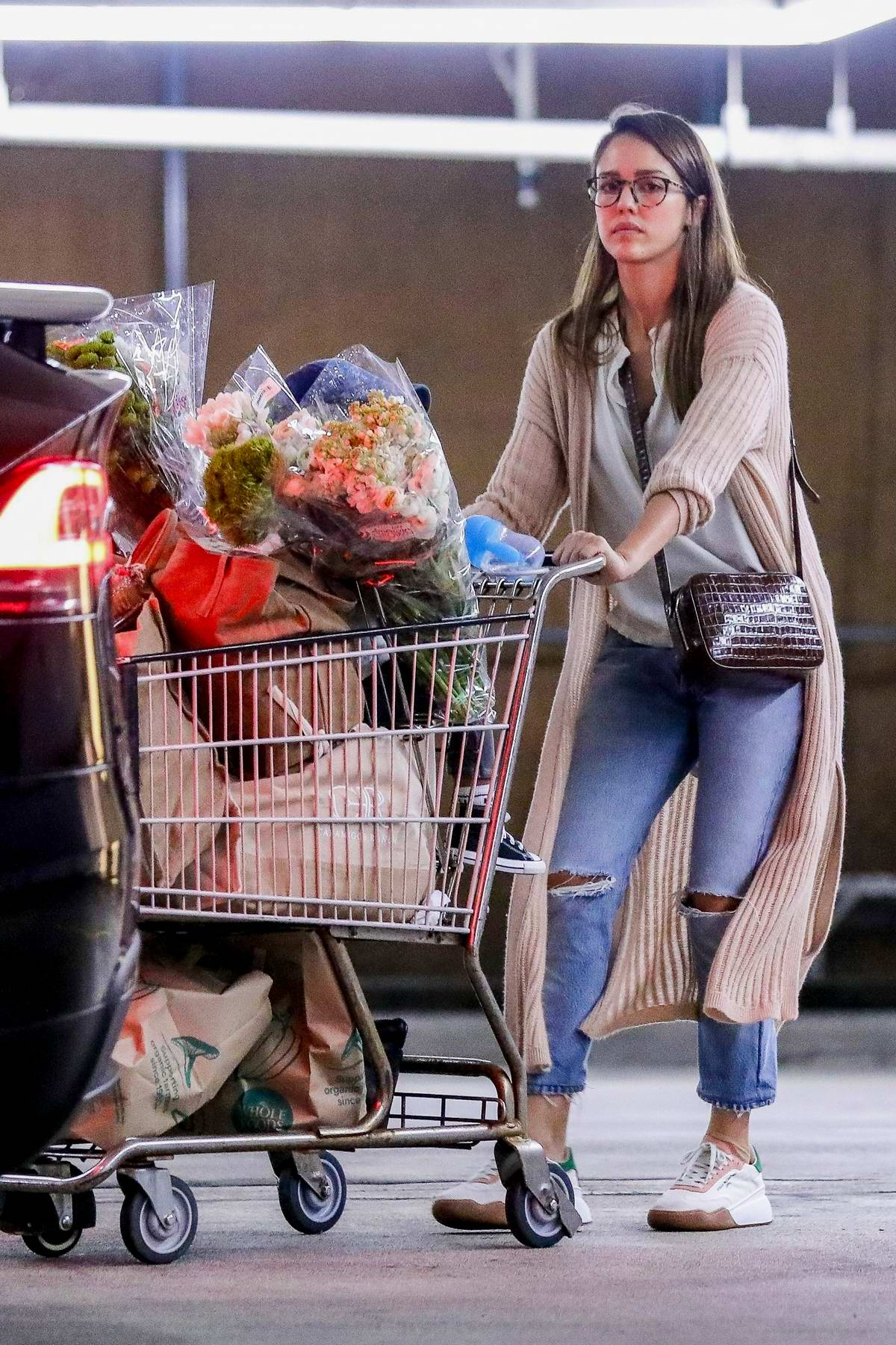 Jessica Alba goes shopping for groceries and flowers in Beverly Hills, California