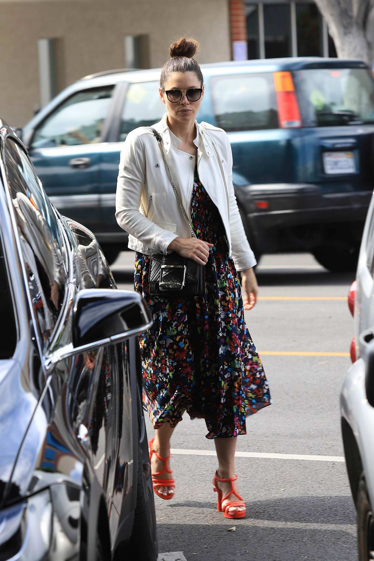 Jessica Biel wears a floral print dress and white jacket for a lunch outing in in Los Angeles