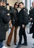 Kaia Gerber greets fans as she leaves her hotel during Milan Fashion Week 2020 in Milan, Italy