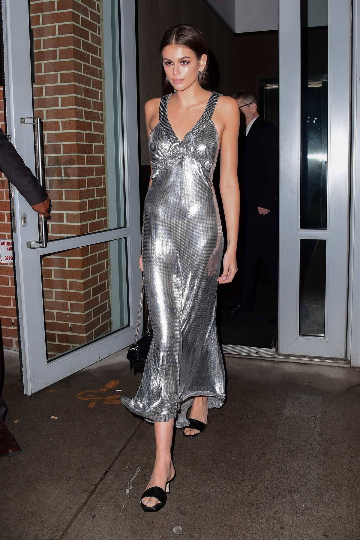 Kaia Gerber looks striking in a silver dress as she heads to Jimmy Choo x Kaia party in New York City