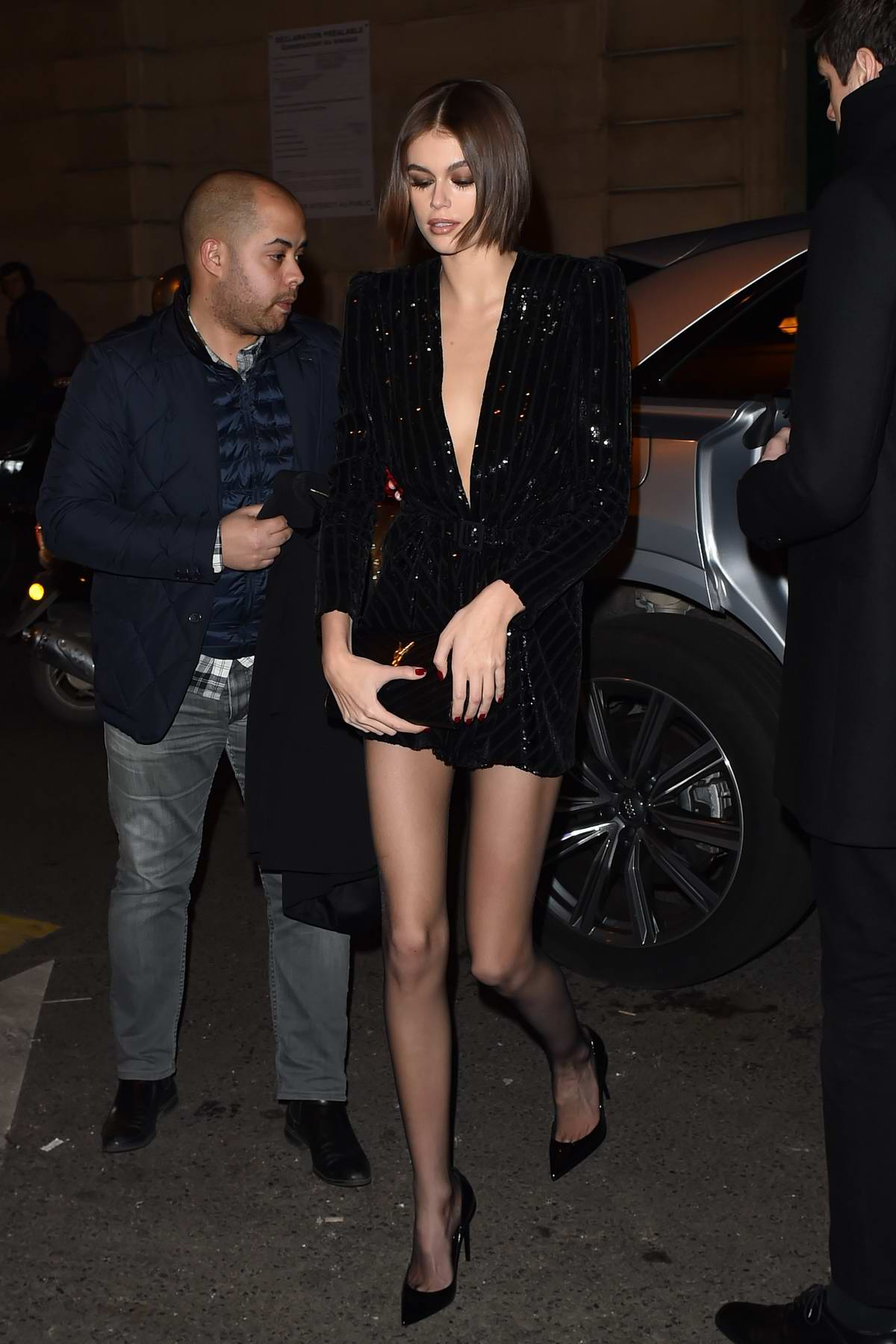 Kaia Gerber looks stunning in a black mini dress as she arrives at the Saint Laurent dinner party in Paris, France