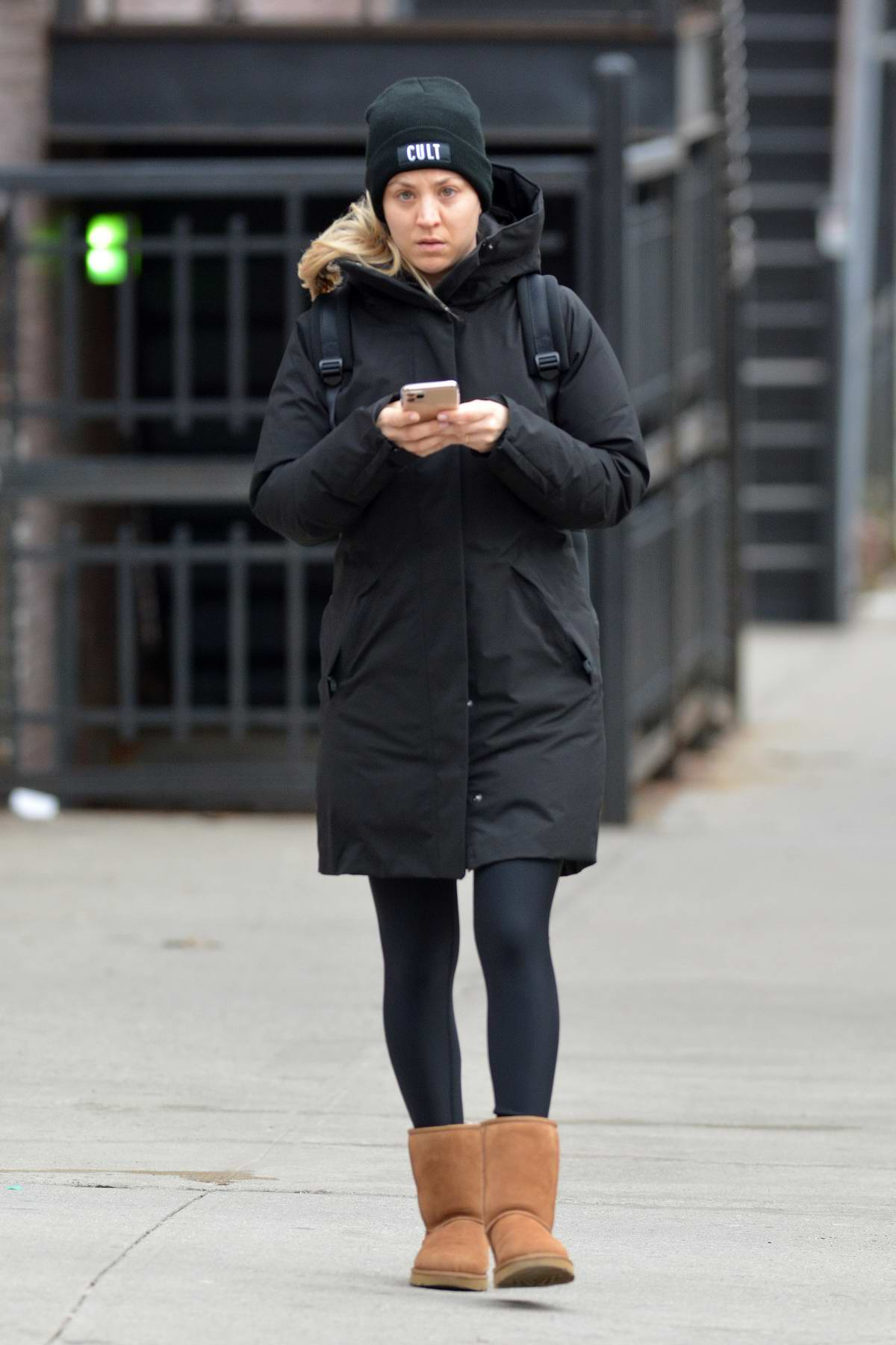 Kaley Cuoco bundles up in a black puffer jacket, leggings and UGG boots while out on a stroll in New York City