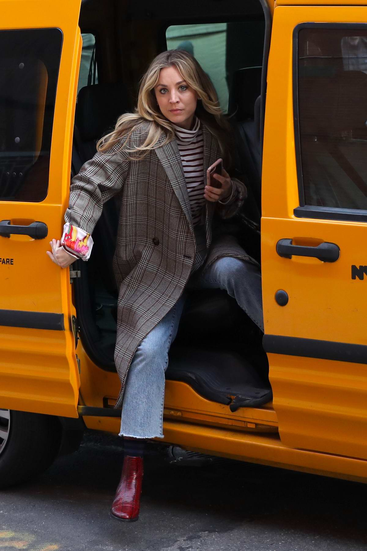 Kaley Cuoco seen getting off of a cab on the set of 'The Flight Attendant' in New York City