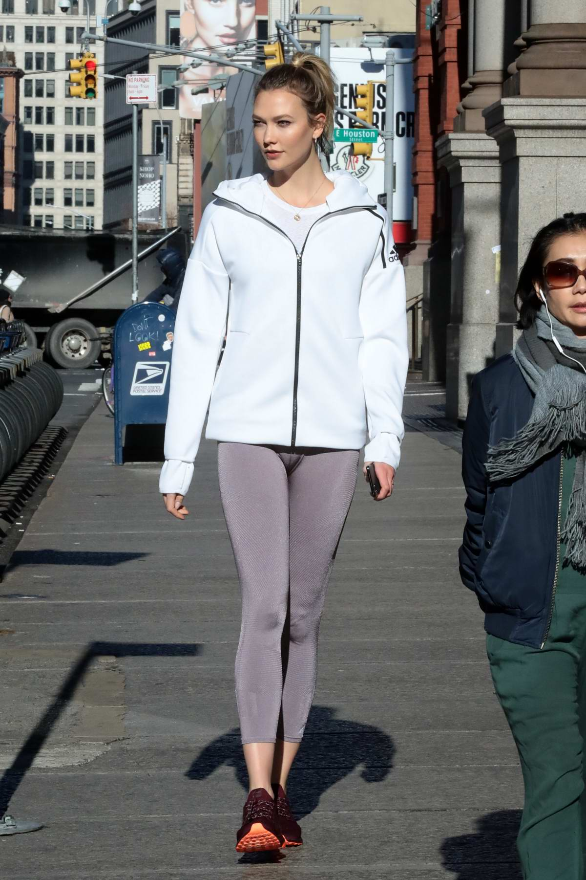 Karlie Kloss shows off her amazing figure in an Adidas hoodie and leggings as she steps out in New York City