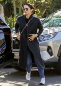 Katharine McPhee wears a long black coat, blue jeans while out on Valentine's Day in West Hollywood, California