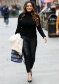 Kelly Brook looks stunning in tight black leather pants and matching top as she leaves Heart Radio in London, UK