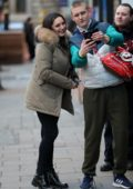 Kelly Brook takes photos and signs autographs for fans as she heads to Heart Radio in London, UK