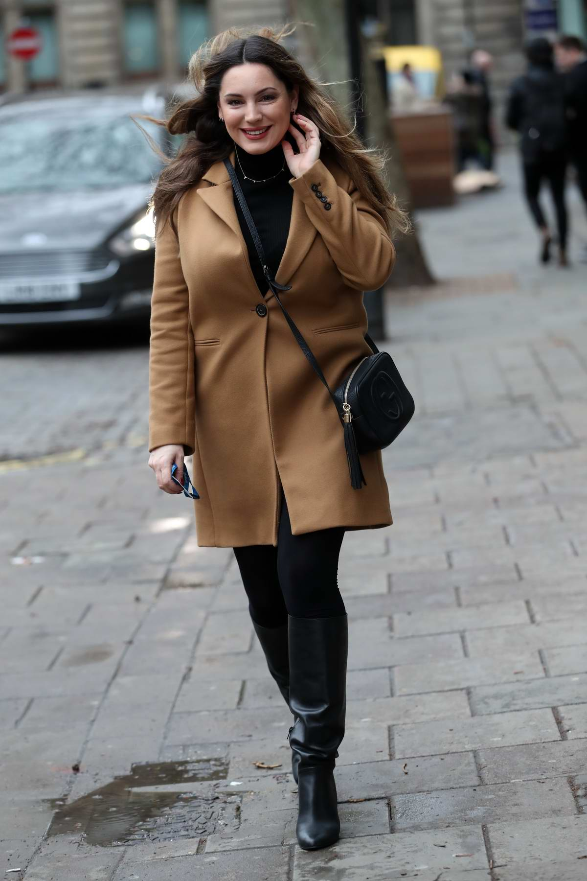 Kelly Brook wears a lovely smile as she arrives at Heart Radio in London, UK