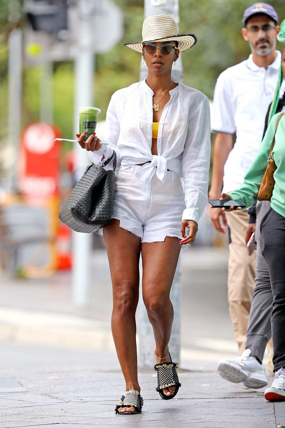 Kelly Rowland dons all-white while out at the Bondi Junction shopping center in Sydney, Australia