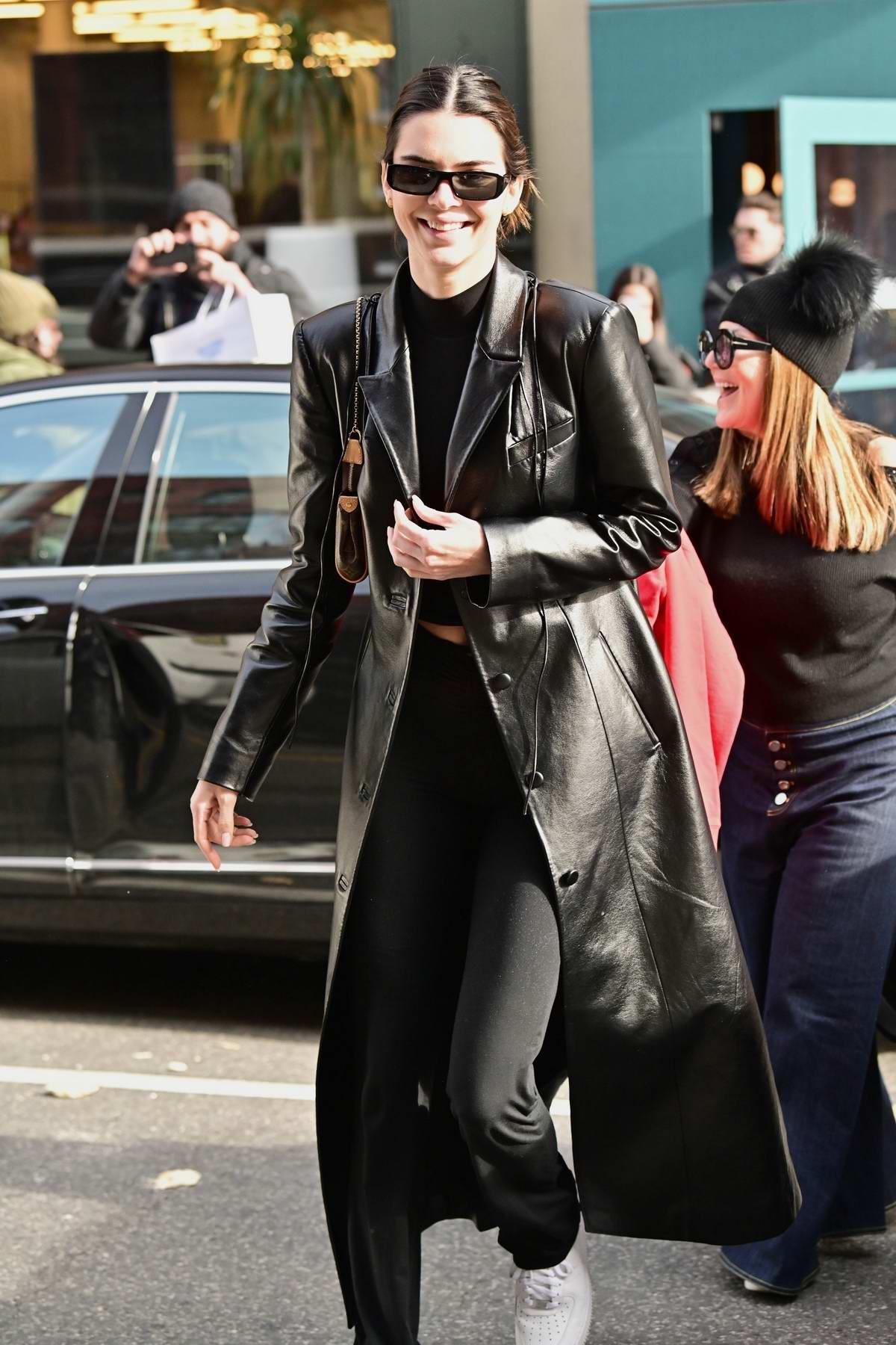 Kendall Jenner is all smiles as she leaves Sadelle's restaurant in SoHo, New York City