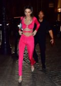 Kendall Jenner looks striking in neon pink as she heads out to a party in New York City