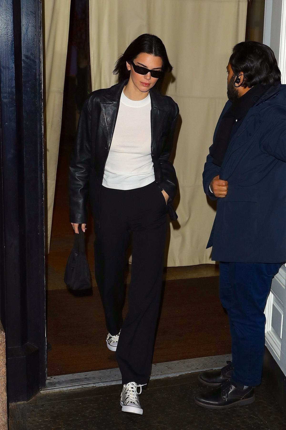 Kendall Jenner looks trendy in a black leather blazer as she heads out of her hotel in SoHo, New York City