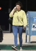 Kesha keep it casual with a sweatshirt and denim tights as she exits a building while on her phone in Los Angeles