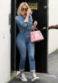 Khloe Kardashian flaunts her curves in a denim jumpsuit as she leaves a studio in Woodland Hills, California