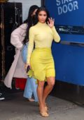 Kim Kardashian shows off her curves in form-fitting yellow ensemble while visiting 'Good Morning America' in New York City