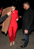Kylie Jenner shows off her curves in a red jumpsuit as she arrives at the Nice Guy in West Hollywood, California