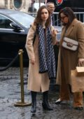 Lily Collins seen wearing a tan coat and scarf while out in Paris, France