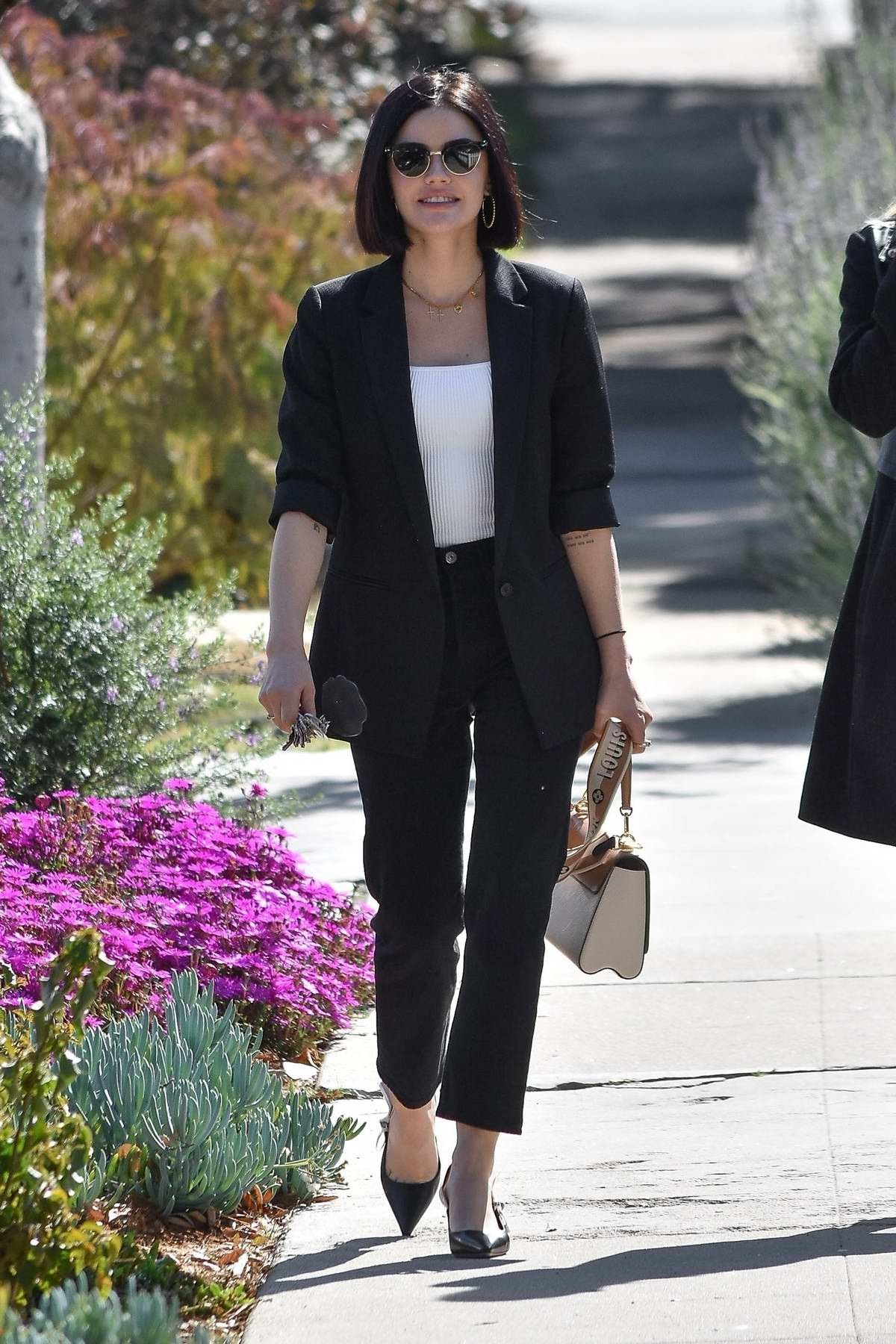 Lucy Hale is all smiles while out for lunch with a friend at Aroma cafe in Studio City, California