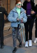 Madelaine Petsch dons a denim puffer jacket with a pair of cool shades as she steps out during Fashion Week in Milan, Italy