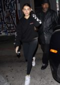 Madison Beer wears a black hoodie and leggings for a dinner outing at Craig's in West Hollywood, California