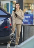Madison Beer wore a beige sweatsuit and Balenciaga sneakers while making a stop at a gas station in Los Angeles