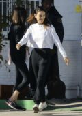 Mila Kunis steps out in black and white as she runs errands in Beverly Hills, California