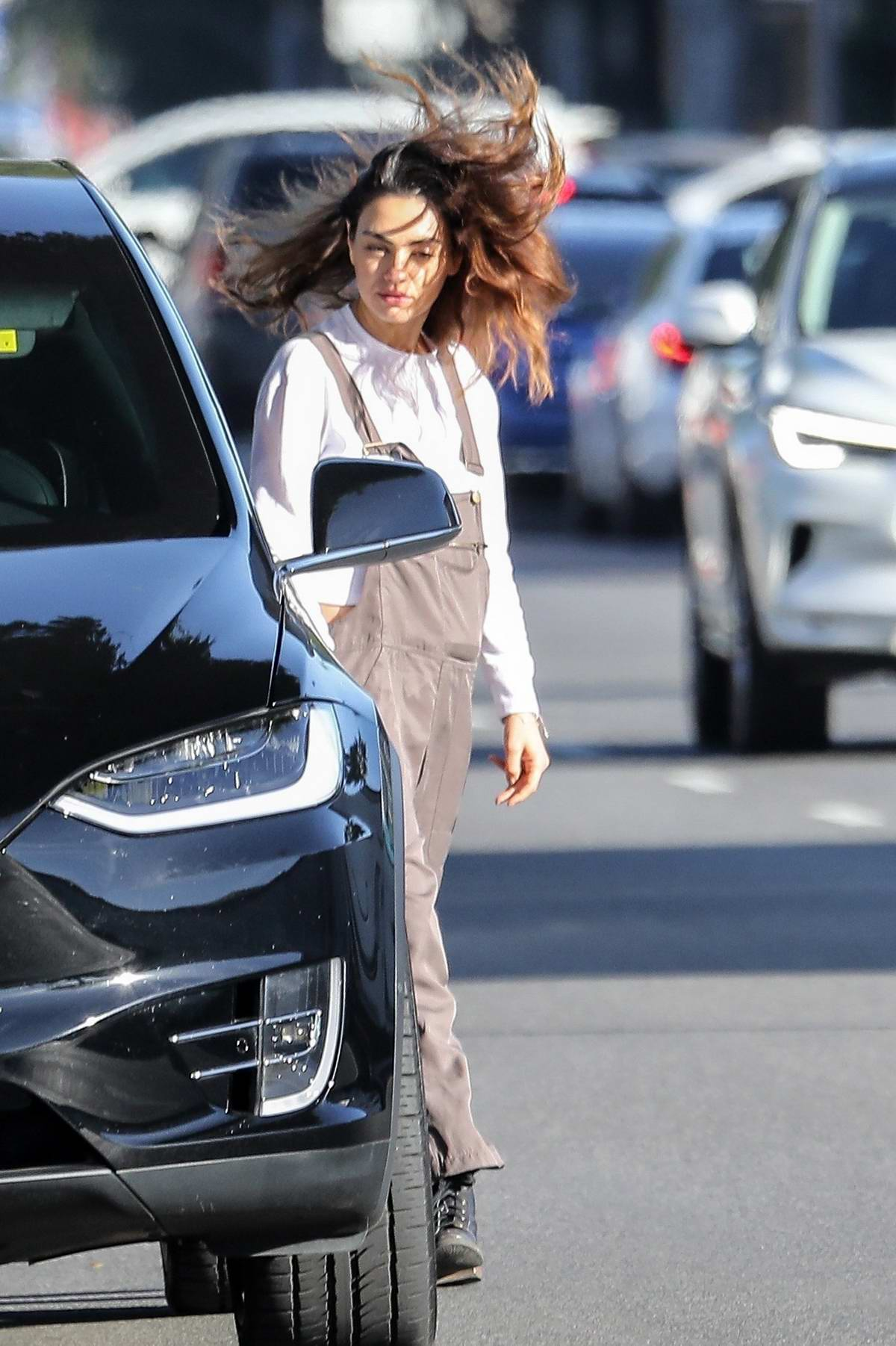 Mila Kunis steps out to grab a coffee on a windy day in Los Angeles