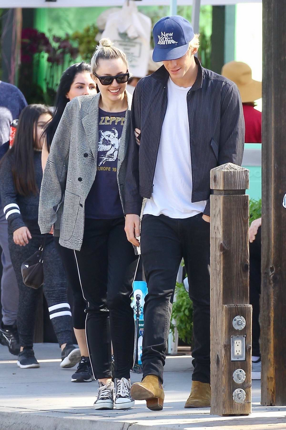 Miley Cyrus and Cody Simpson are all smiles while shopping in Calabasas, California