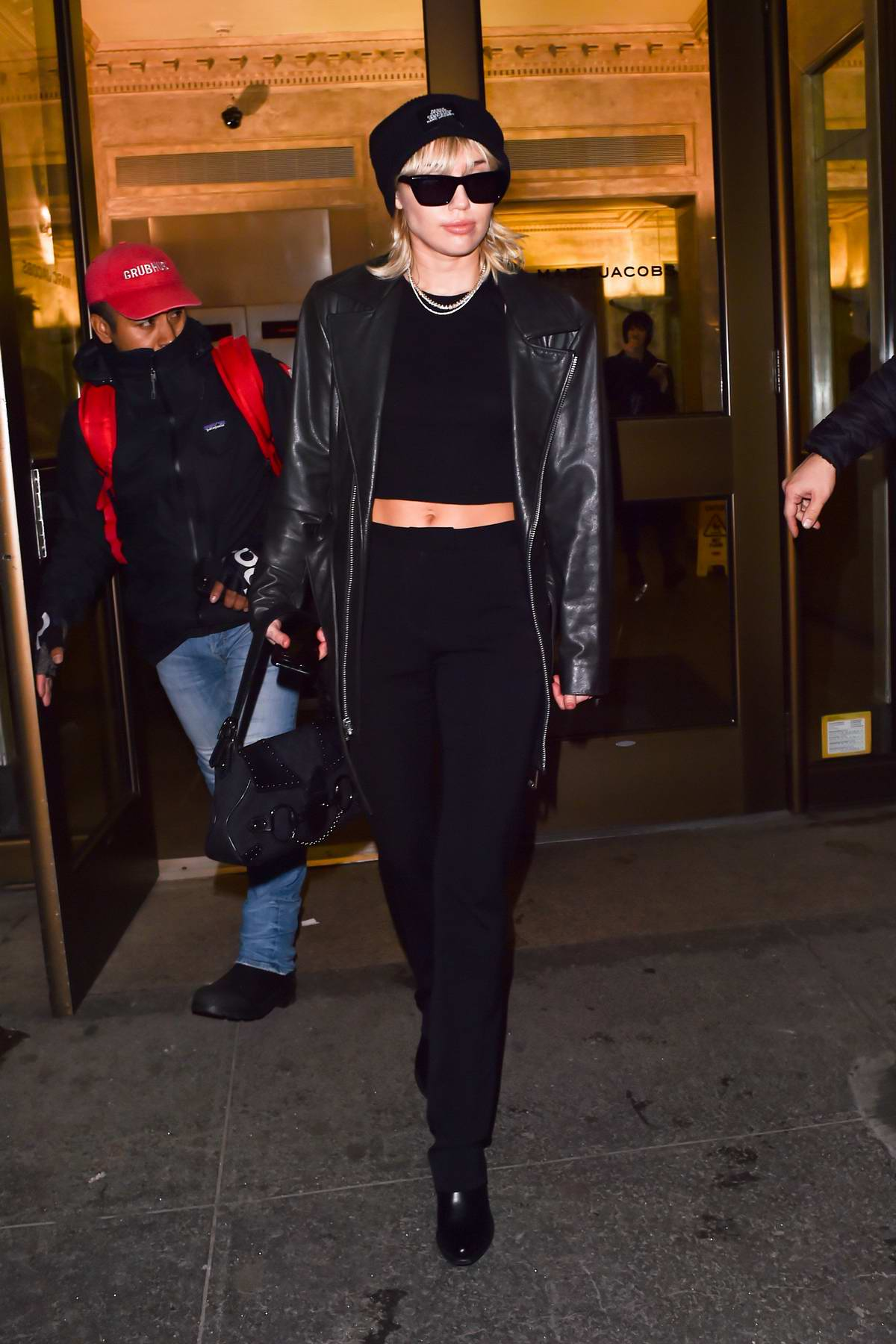 Miley Cyrus dons all-black as she leaves Marc Jacobs head office after a fashion fitting in New York City
