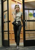 Miley Cyrus keeps it casual in a grey tee and jeans as she leaves an office building in Los Angeles