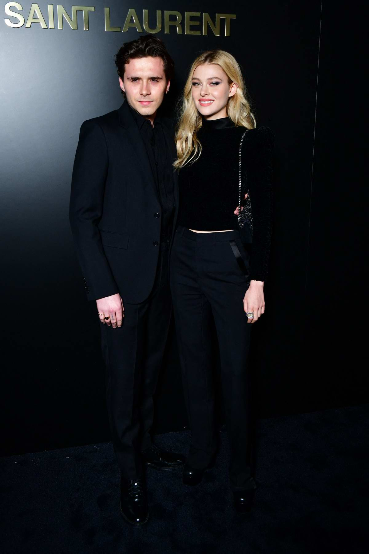 Nicola Peltz and Brooklyn Beckham attend the Saint Laurent show, F/W 2020 during Paris Fashion Week in Paris, France