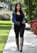 Nikki Bella rocks black spandex jumpsuit and snakeskin boots while visiting a friend in Brentwood, California