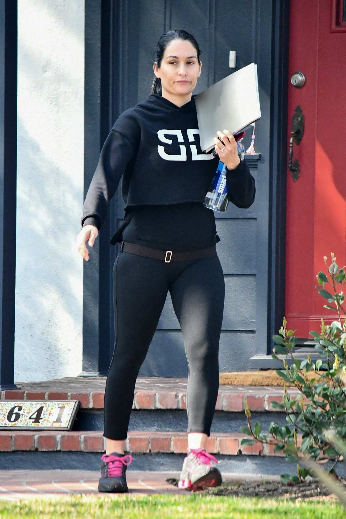 Nikki Bella sports a hoodie and leggings as she hits up a supermarket in Studio City, California