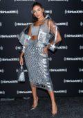 Olivia Culpo attends SiriusXM on radio row for 2020 Super Bowl LIV at the Miami Beach Convention Center in Miami, Florida