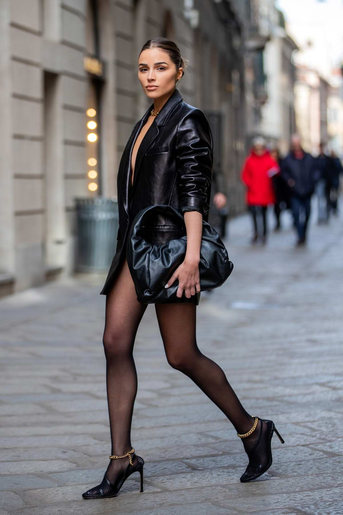 Olivia Culpo is all style in black leather blazer dress as she steps out during Milan Fashion Week 2020 in Milan, Italy