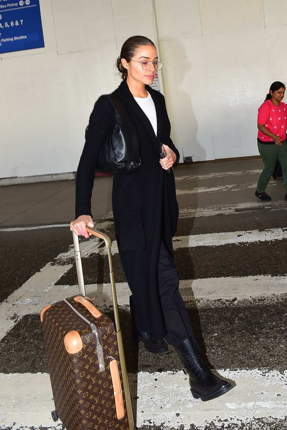 Olivia Culpo looks tired after a long flight from Milan to LAX airport in Los Angeles
