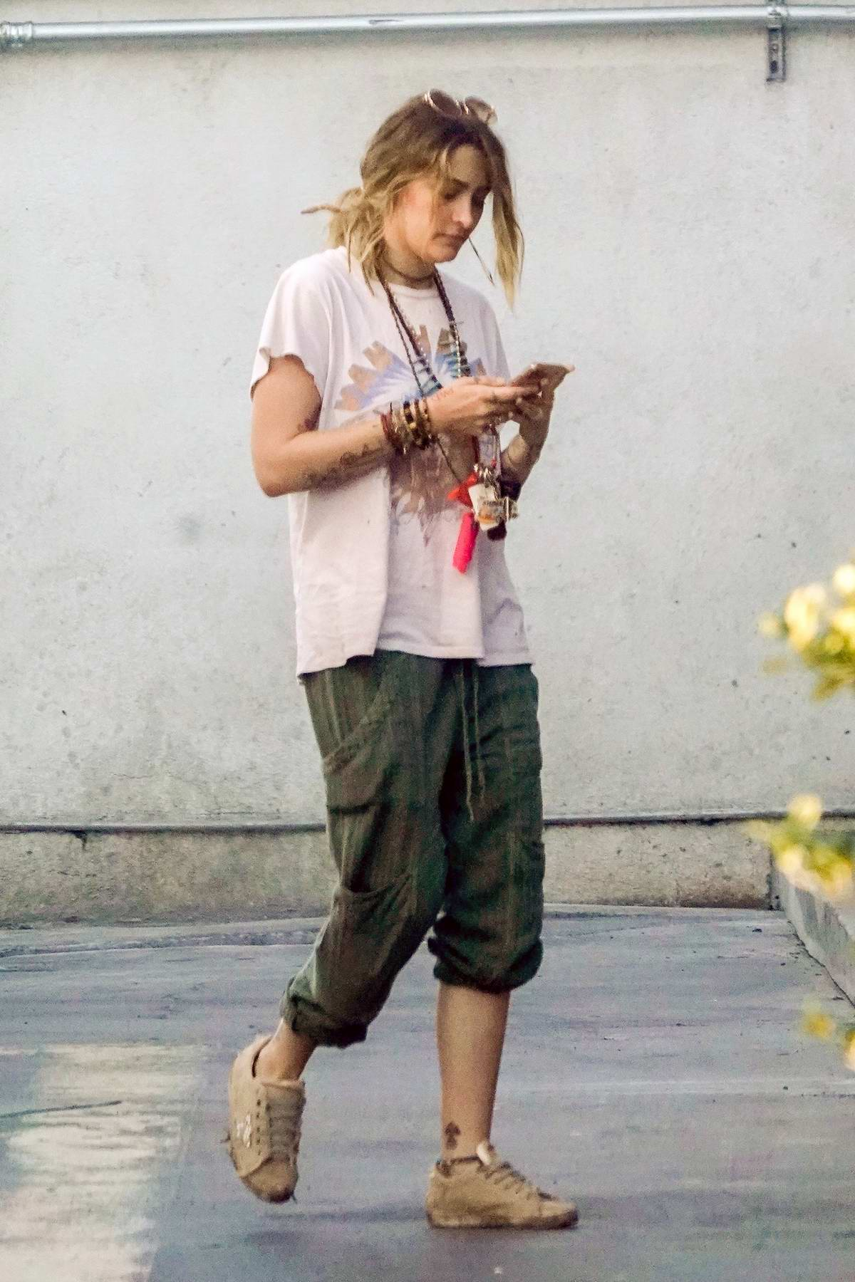 Paris Jackson seen checking her phone while out to grab a pack of smoke in Los Angeles