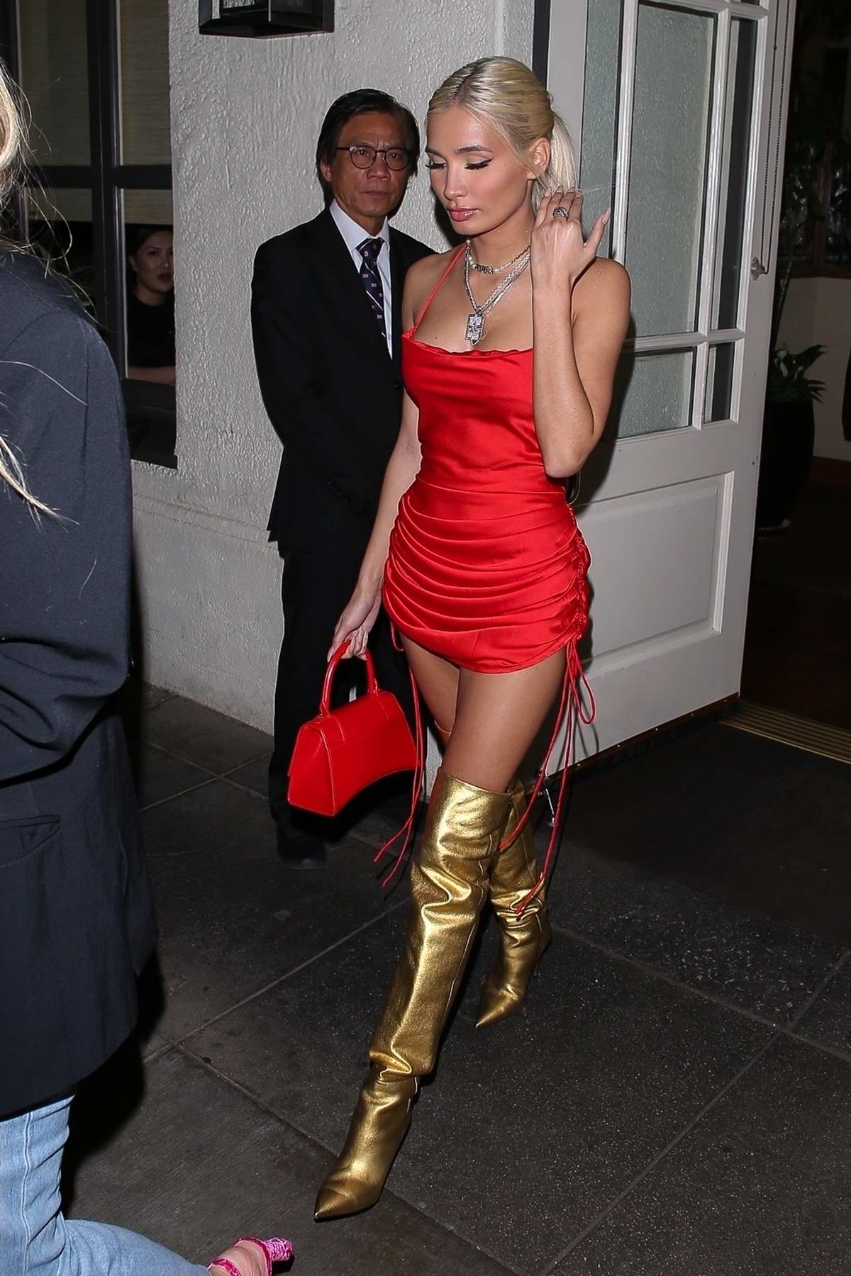 Pia Mia wears red mini dress and gold thigh-high boots as she leaves Madeo Italian restaurant in Beverly Hills, California