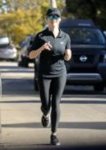 Reese Witherspoon looks toned in black leggings as she goes jogging in Brentwood, California