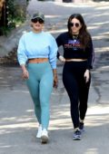 Rita Ora flaunts her abs in a blue crop top and leggings while out on a hike with friends in Los Angeles